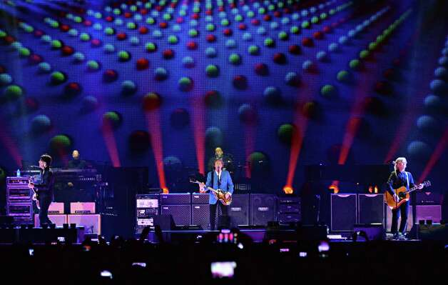 Paul McCartney, center, brings his Out There Tour to the Times Union Center Saturday July 5, 2014, in Albany, NY.  (John Carl D'Annibale / Times Union) ORG XMIT: MER2014070520592874 Photo: John Carl D'Annibale / 00027433A
