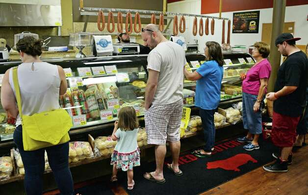 Customers queue up at Fred the Butcher's deli counter Tuesday May 26, 2015 in Clifton Park, NY.  (John Carl D'Annibale / Times Union) Photo: John Carl D'Annibale / 00031954A