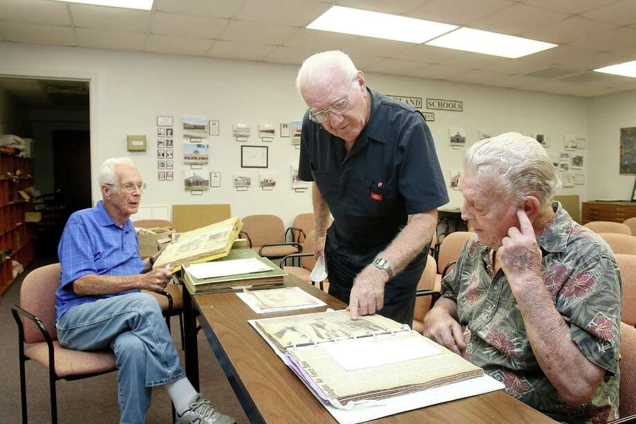 "Pearland Historical Society members John ""Mickey"" Mark, left, Luther Cunningham and Carl Talbot review some of the group's collection, which is kept in a room in a Pearland school district building. Photo: Pin Lim, Freelance / Copyright Forest Photography, 2015."