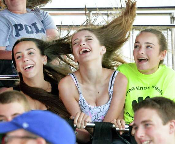 Riding the Super-Himalalaya are, from left, Ariel Rourke, 14, Cailyn Toomey, 14, and Kristen Hamley, 13, all of Berne, at the Altamont Fair Thursday August 14, 2014, in Altamont, NY.  (John Carl D'Annibale / Times Union) ORG XMIT: MER2014081415063198 Photo: John Carl D'Annibale / 00028138A