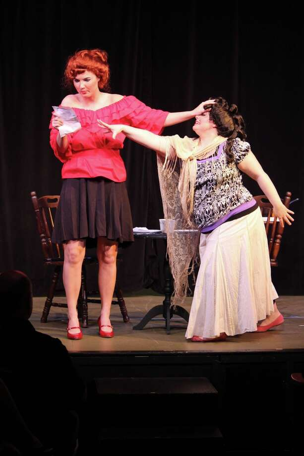 "Megan Nix, left, keeps Cindy Lou Parker at arms length in ""Amante de la Cabra y el Diablo Juan Pablo"" by L. Robert Westeen, one of the productions from a previous Spontaneous Smattering event, in which plays are written, rehearsed, designed and performed within 25 hours. Photo: Christine Weems"
