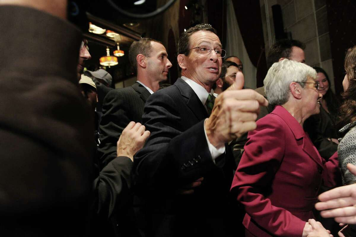 Democratic gubernatorial candidate Dannel P. Malloy delivers his speech with lieutenant governor candidate Nancy Wyman at The Society Room on election night in Hartford on Nov. 2, 2010.