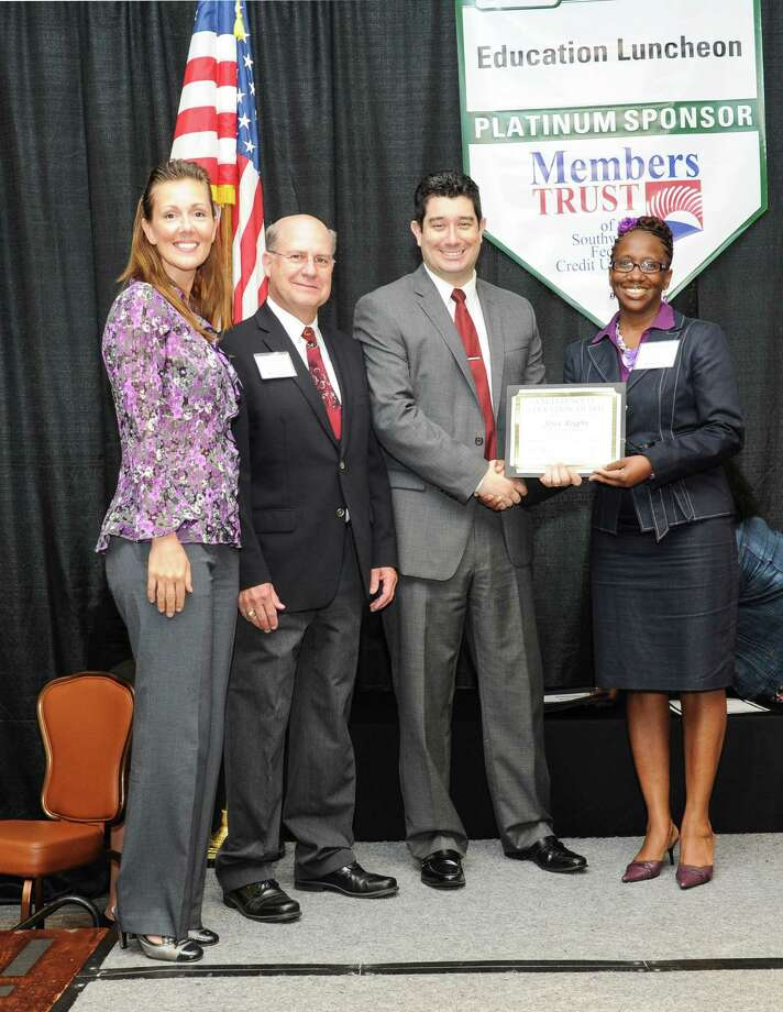 Joyce Rogers, right, an instructional specialist with Waltrip High School in the Heights, receives a certificate honoring her as Educator of the Year for 2015 from Jacob Millwee, president of the Greater Heights Chamber of Commerce,  second from right. Also pictured, from left, are former Waltrip High School principal Andria Schur and Brian Gilbert, chairman of the Heights chamber.     Submitted by the Greater Heights Chamber of Commerce Photo: Greater Heights Chamber Of Comm / Photography byDesign www.pbyd.com