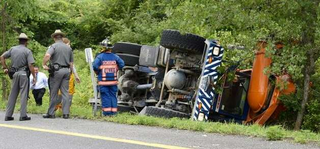 State Police investigate a cement truck that rolled over at Exit 11-E off I 90 in Schodack, NY, on Tuesday, June 16, 2015. (Skip Dickstein/Times Union)