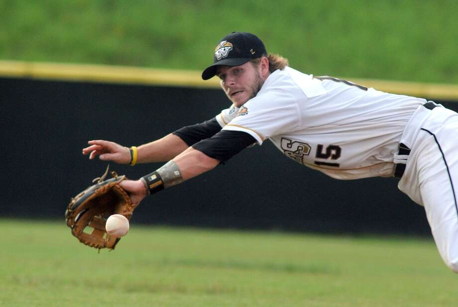 The Woodlands Strykers shortstop Lance Miles makes a play against the Victoria Generals. Photo: Jerry Baker, Freelance