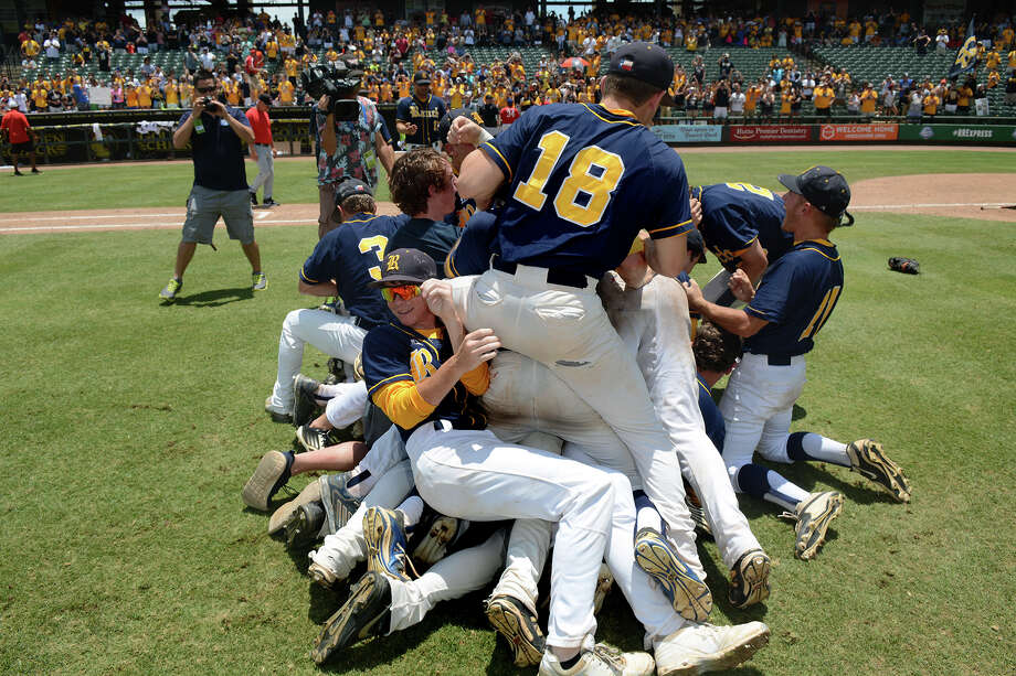 Cy Ranch junior Mason Zientek, bottom left, is all smiles as his teammates pile on to celebrate their 3-0 win over Arlington Martin in the 2015 UIL Class 6A State Baseball Championship final at Dell Diamond in Round Rock last Saturday. Photo: Jerry Baker, Freelance