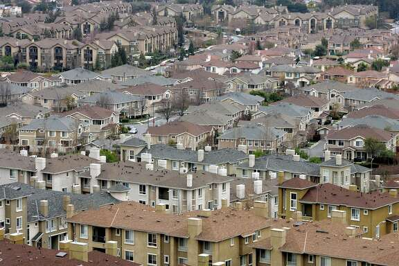 FILE - In this Jan. 21, 2009 file photo, a residential area is seen in San Jose, Calif. California cities have broad authority to require builders to include a percentage of affordable housing in new projects, the state Supreme Court ruled Monday, June 15, 2015. The decision keeps affordable housing requirements approved in more than 170 California cities intact, including San Francisco and cities in Silicon Valley, where skyrocketing housing prices have led to calls for more affordable housing. (AP Photo/Marcio Jose Sanchez, File)
