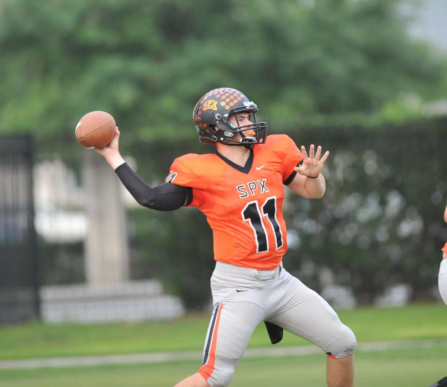 St. Pius X.  spring football scrimmage game, 5-22-2015.  Quarterback Clay Roberts (11) sets up to pass to a teammate. Photo: Eddy Matchette, Freelance / Freelance