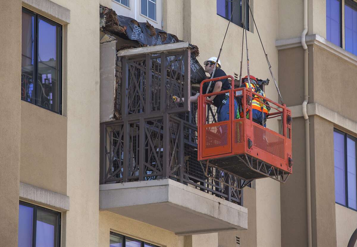 Officials check out the damage at the Library Gardens apartment complex, Tuesday, June 16, 2015, in Berkeley, Calif. The apartment's four-story balcony collapsed, killing six people and injuring at least seven others.