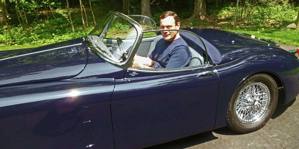 David Porter of Darien behind the wheel of his 1958 Jaguar XK-150 at his home. Porter will be showing the car at the Darien Auto Collector's Father's Day Car Show at the Lockwood Mathews Mansion in Norwalk Sunday, June 21,, 2015.