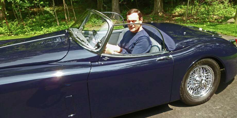 David Porter of Darien behind the wheel of his 1958 Jaguar XK-150 at his home. Porter will be showing the car at the Darien Auto Collector's Father's Day Car Show at the Lockwood Mathews Mansion in Norwalk Sunday, June 21,, 2015. Photo: Martin Cassidy / Hearst Connecticut Media / Darien News