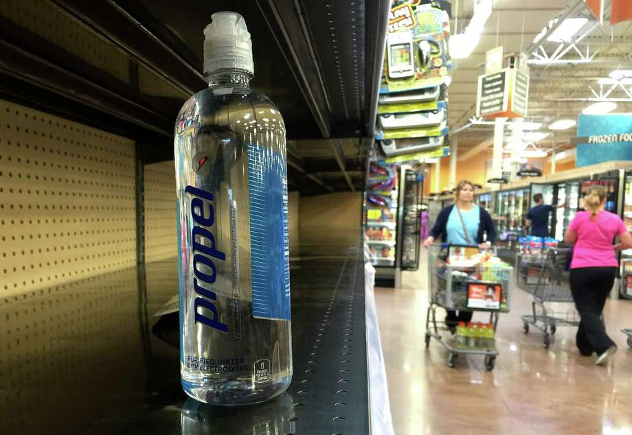 A bottle of water sits on a nearly empty shelf at a grocery store as residents around Houston quickly snatched up bottled water and other supplies Monday June 15, 2015, in Houston. The historic rainfall that inundated Texas in May continues to leave the soil saturated and rivers engorged, but a scientist involved in a NASA-funded research project says it also could strengthen a storm moving inland from the Gulf of Mexico. (Jason Fochtman/Conroe Courier via AP) Photo: Jason Fochtman, MBR / Conroe Courier
