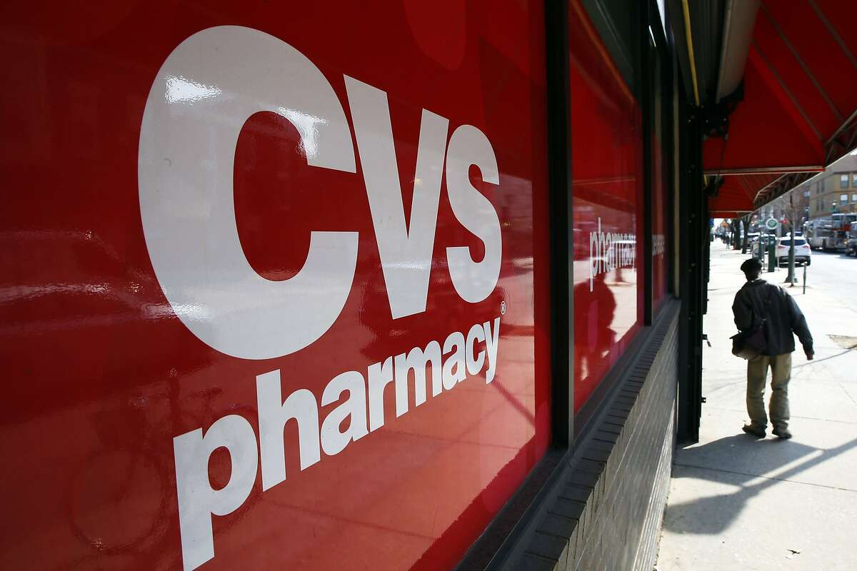 FILE - This March 25, 2014, file photo, shows a CVS store in Philadelphia. Target announced Monday, June 15, 2015, that it is selling its pharmacy and clinic businesses to drugstore chain CVS Health for about $1.9 billion in a deal that combines the resources of two retailers seeking to polish their reputations as health care providers. (AP Photo/Matt Rourke, File)