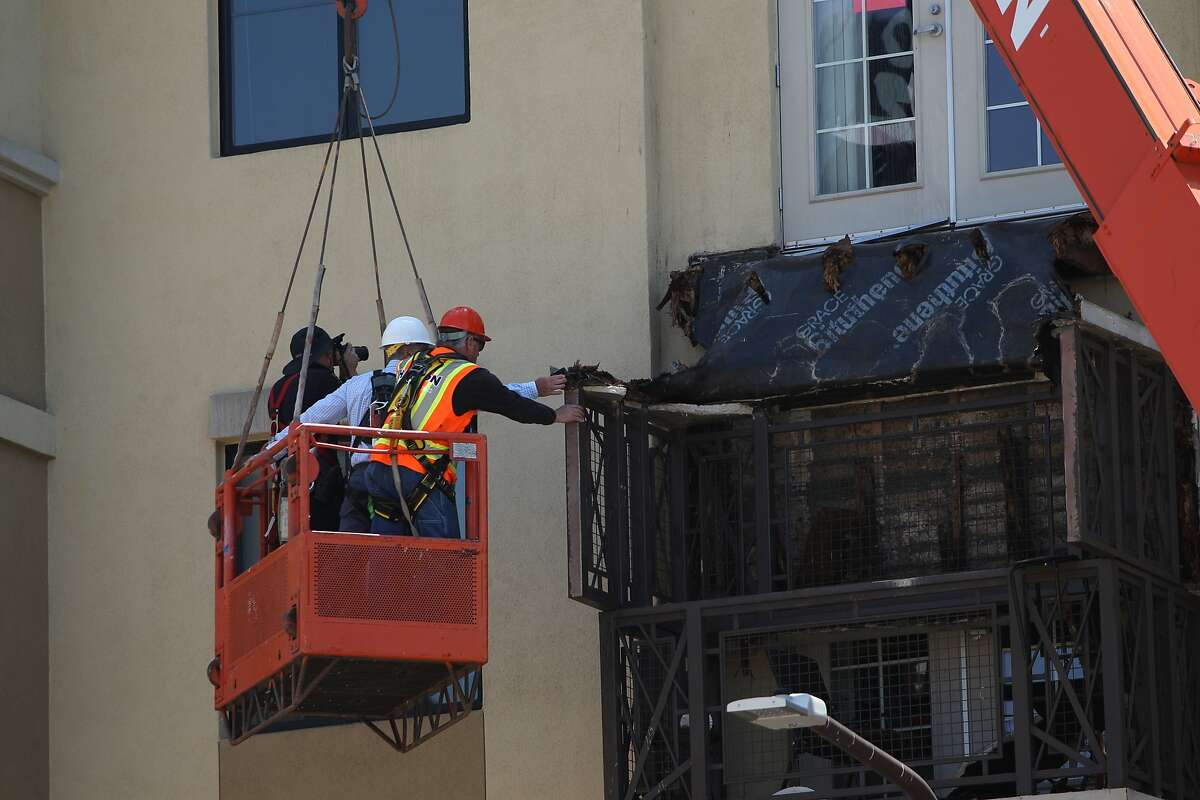 A collapsed balcony is inspected at 2020 Kittredge Street in Berkeley, California, on Tuesday, June 16, 2015. The collapse, which took place in the early hours of Tuesday, killed 6 and injured others.