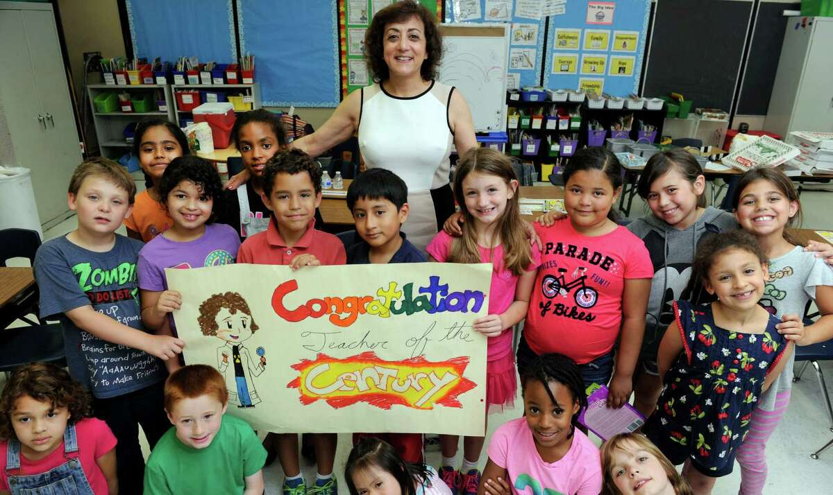 Nancy Michael, surrounded by her second-grade class at Pembroke Elementary School, has been named Danbury's Teacher of the Year.