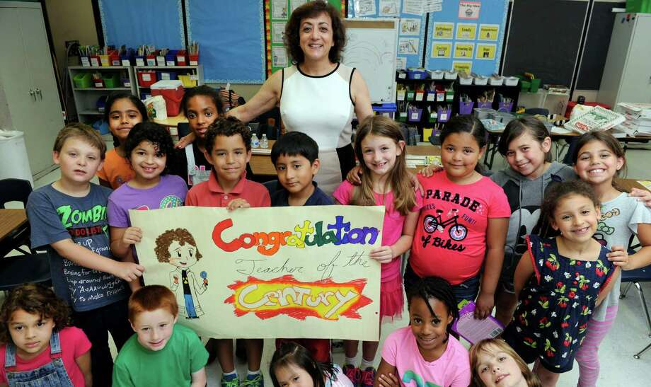 Nancy Michael, surrounded by her second-grade class at Pembroke Elementary School, has been named Danbury's Teacher of the Year. Photo: Carol Kaliff / Hearst Connecticut Media / The News-Times