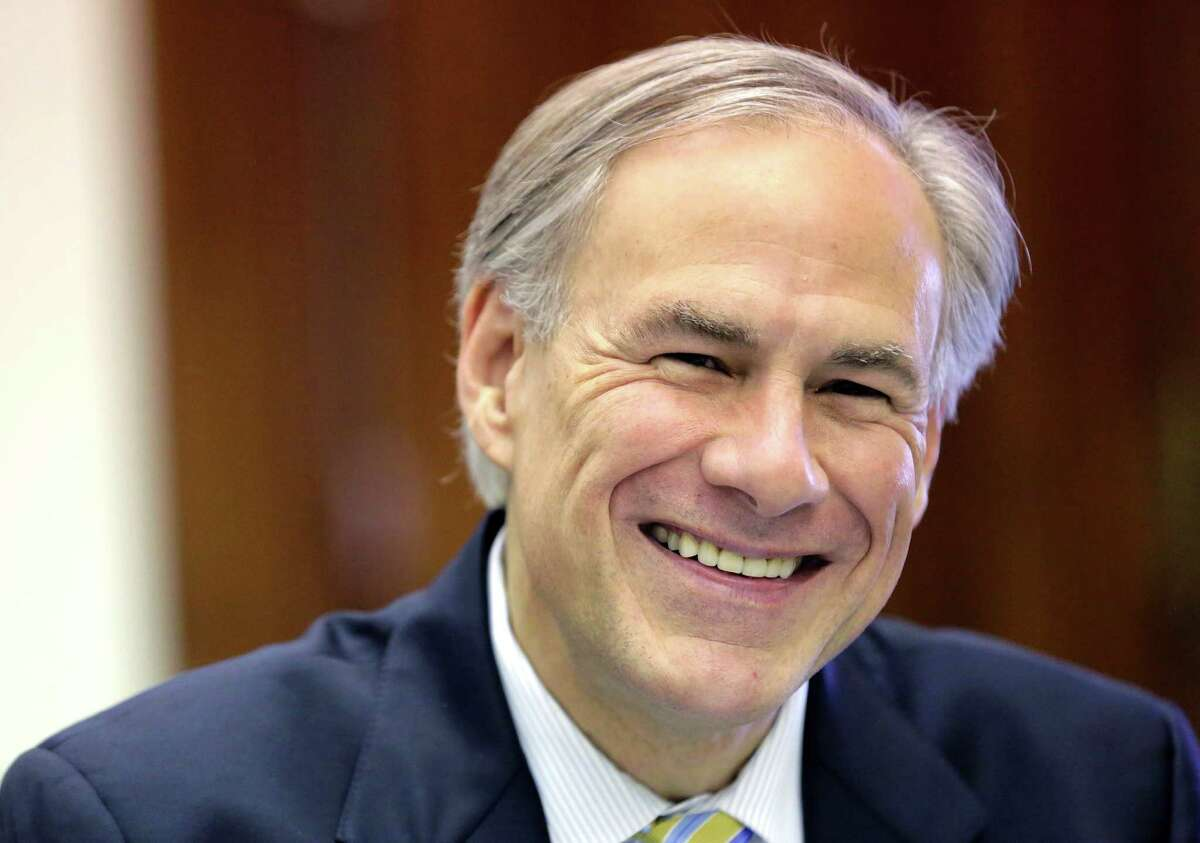 Texas Gov. Greg Abbott shares a laugh with news reporters during a round table talk in his office at the Texas Capitol, Wednesday, June 3, 2015, in Austin, Texas. (AP Photo/Eric Gay)