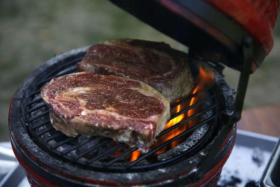 Chef Louis Maldonado of Spoonbar grills rib eye in Healdsburg. Photo: Liz Hafalia, The Chronicle
