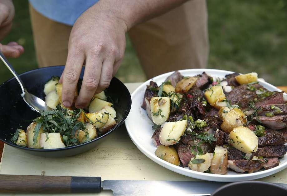 "Chef Louis Maldonado of Spoonbar plates grilled rib-eye and potato ""hobo packs""  in Healdsburg, California, on Monday, June 15, 2015. Photo: Liz Hafalia, The Chronicle"
