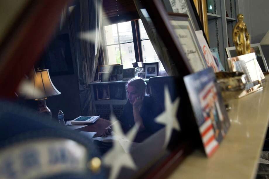 Sen. Kirsten Gillibrand, D-N.Y., is reflected in a framed U.S. flag while being interviewed on Capitol Hill on the issue of military sexual assaults. Photo: Jacquelyn Martin /Associated Press / AP