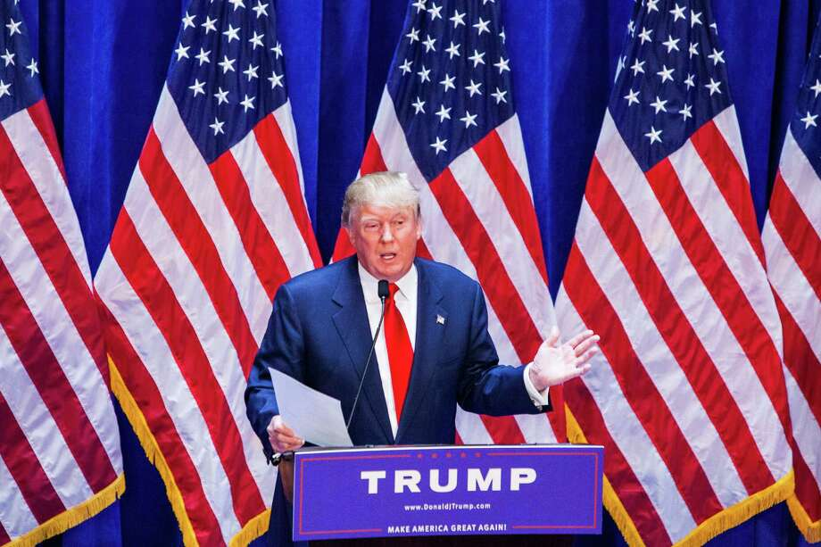 Business mogul Donald Trump holds documents certifying his net worth is 8.7 billion dollars as he announces his candidacy for the U.S. presidency at Trump Tower on Tuesday in New York City. Trump is the 12th Republican who has announced running for the White House. Photo: Christopher Gregory /Getty Images / 2015 Getty Images