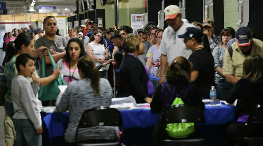 People line up to enroll for health insurance under the Affordable Care Act at the Alamodome in March 2014. Nationally, about 1 million children gained health insurance between 2013 and 2014, according to a study by the Robert Wood Johnson Foundation. Photo: Express-News File Photo / © 2014 San Antonio Express-News
