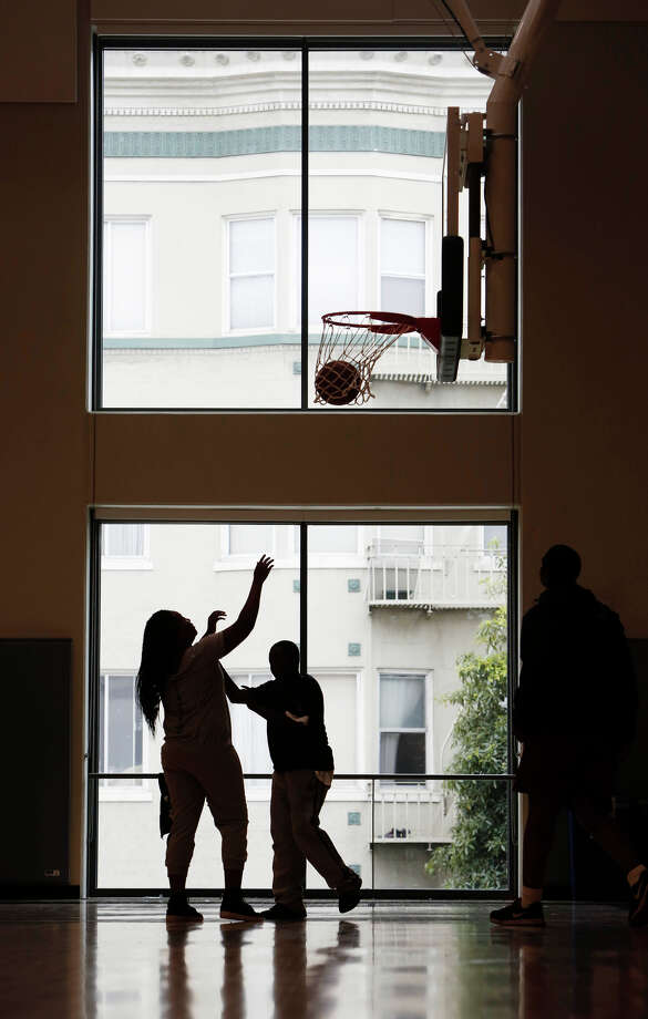 Children play on the basketball court in front of the ample windows in the gym of the impressive new Boys & Girls Club building on Fulton Street near Civic Center. Photo: Lea Suzuki / Lea Suzuki / The Chronicle / ONLINE_YES