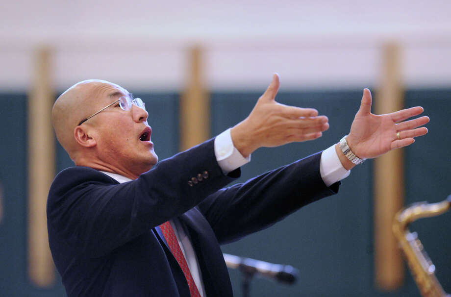 Greenwich High School Band Director John Yoon during a performance by his band, the Greenwich High School Jazz Ensemble, at Glenville School, Thursday night, March 14, 2013. Photo: Bob Luckey / Bob Luckey / Greenwich Time