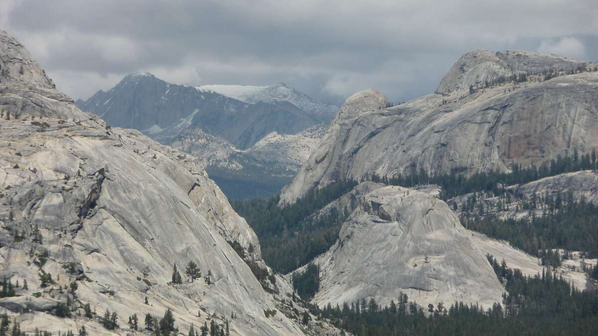 From Olmstead Point near Tioga Lake on Tioga Road, the front country to Tuolumne Meadows in Yosemite National Park, this photo was shot in June, 2015, toward Polly Dome and Tioga Pass as afternoon thunderstorms build