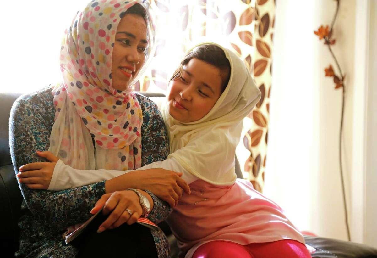 Afghan refugees Zeba Mohammad Arif left, and her daughter Mahnaz Kashmiri in their apartment in Houston.