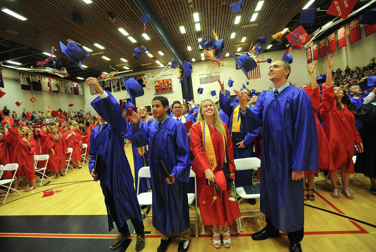 Caps fly high at the conclusion of the Foran High School graduation in Milford, Conn. on Tuesday, June 16, 2015.