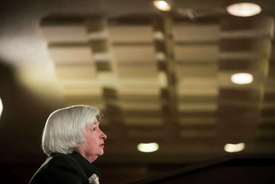 Federal Reserve Chair Janet Yellen participates in a news conference at the end of the Federal Open Market Committee meeting in March.Yellen is expected to sketch a slightly brighter picture of the economy at this month's news conference. Photo: Kevin Wolf /Associated Press / FR33460 AP
