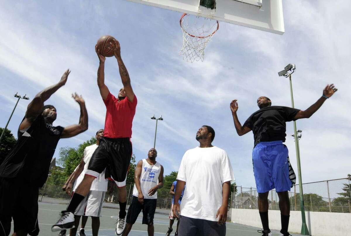 A game of pickup basketball played every weekend on the courts at Washington Park Saturday, June 30, 2012, in Albany N.Y. (Michael P. Farrell/Times Union archive)