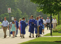 Scenes from the commencement ceremony at Darien High School in Darien, Conn., on Tuesday, June 16, 2015.