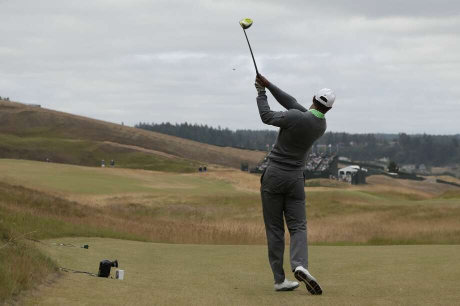 Q: What are your impressions of the golf course here at Chambers Bay? TIGER WOODS: Well, it's certainly different for a U.S. Open, that's for sure. We normally play pretty traditional golf courses where back of the tee is narrow, fairways are high, and from fast greens. They have that here, but some of the holes you can move up 100 yards, and the greens are getting firm. But it's more of the shape of the golf course. There's so many different ways that you can play it, and sometimes you have to be able to play it. I think one of the more dramatic things I've noticed is how different it plays from morning to afternoon. It gets so much faster and drier. You just feel it as the day wears on how much this golf course can dry out, and it certainly will. The morning times versus afternoon times, it's very different. Photo: Charlie Riedel, AP