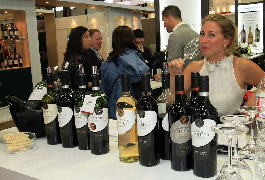 "A woman tastes white wine wine at the international wine fair ""Vinexpo"" in Bordeaux, southwestern France. How much drinking constitutes heavy drinking? The answer is not once-size-fits-all. Photo: Bob Edme /Associated Press / AP"