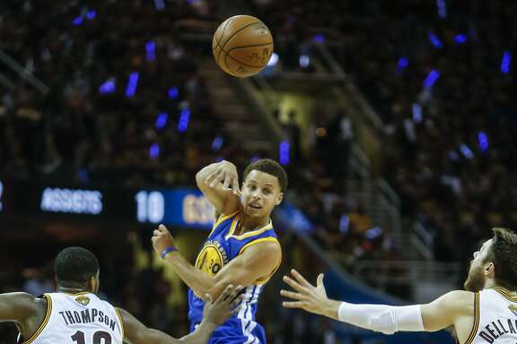 Golden State Warriors' Stephen Curry passes off in the first period during Game 6 of The NBA Finals between the Golden State Warriors and Cleveland Cavaliers at The Quicken Loans Arena on Tuesday, June 16, 2015 in Cleveland, Ohio.