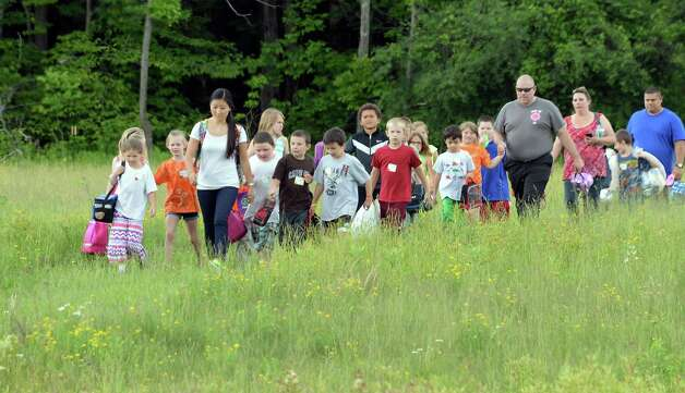 Second grade teacher Michelle Pahl, left center, leads Berne Knox Westerlo Elementary School students and parents  along a trail to the Thacher Nature Center for a Pollinator Protection Week program Tuesday June 16, 2015 in Voorheesville, NY.  (John Carl D'Annibale / Times Union) Photo: John Carl D'Annibale / 00032297A