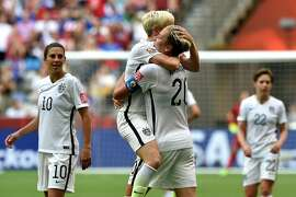 VANCOUVER, BC - JUNE 16:  Abby Wambach #20 of the United States celebrates with Megan Rapinoe #15 after Wambach scores a goal in the first half against Nigeria in the Group D match of the FIFA Women's World Cup Canada 2015 at BC Place Stadium on June 16, 2015 in Vancouver, Canada.  (Photo by Rich Lam/Getty Images)