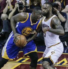 Golden State Warriors' Draymond Green tries to get past Cleveland Cavaliers' LeBron James in the second period during Game 6 of The NBA Finals between the Golden State Warriors and Cleveland Cavaliers at The Quicken Loans Arena on Tuesday, June 16, 2015 in Cleveland, Ohio.