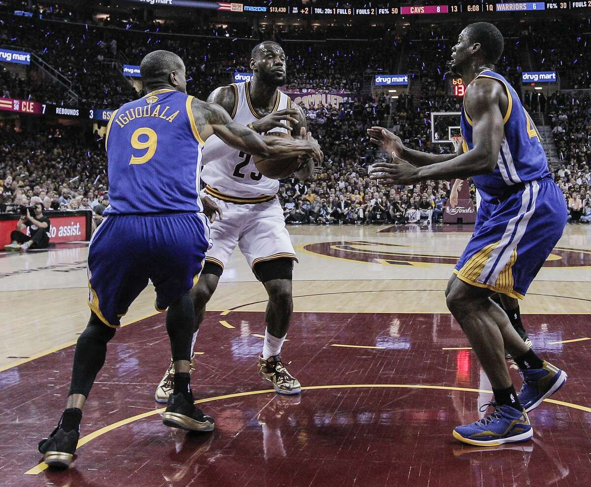 Golden State Warriors' Andre Iguodala gets a hand on a Cleveland Cavaliers' LeBron James shot attempt in the first period during Game 6 of The NBA Finals between the Golden State Warriors and Cleveland Cavaliers at The Quicken Loans Arena on Tuesday, June 16, 2015 in Cleveland, Ohio.