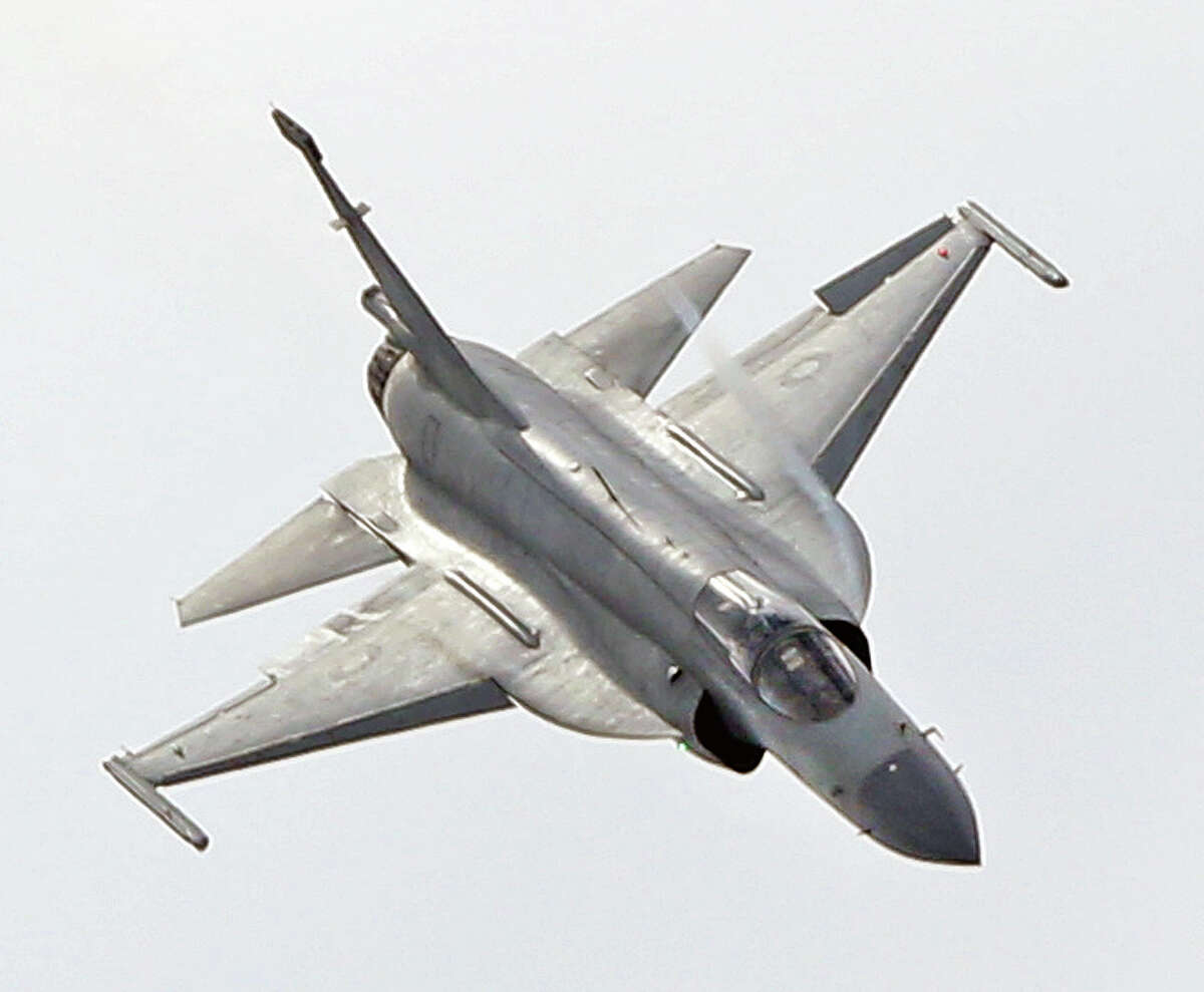 The JF-17 Thunder multi-role fighter jointly developed by China and Pakistan performs its demonstration flight at the Paris Air Show in Le Bourget, north of Paris, Tuesday June 16, 2015. Some 300,000 aviation professionals and spectators are expected at this week's Paris Air Show, coming from around the world to make business deals and see dramatic displays of aeronautic prowess and the latest air and space technology.