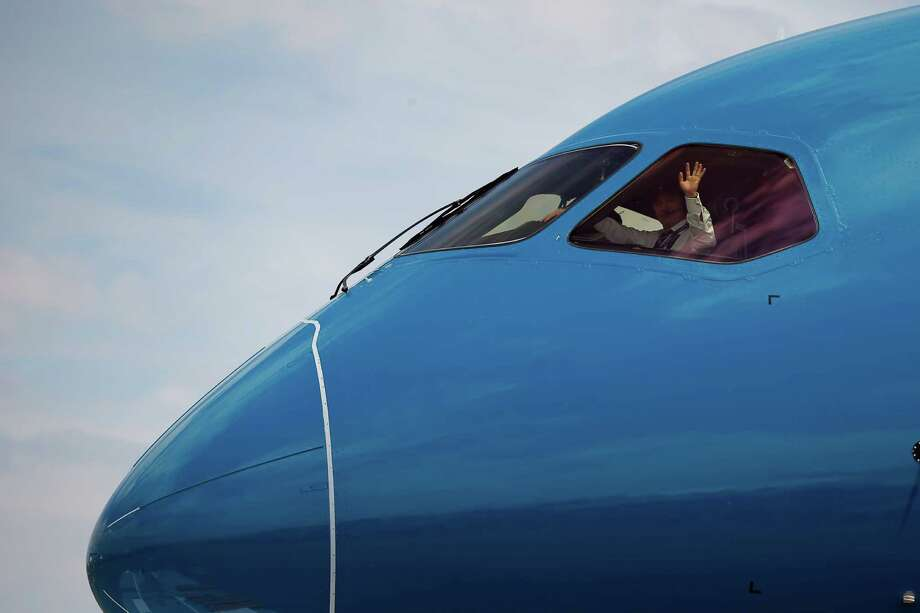 The pilot of the Boeing 787 Dreamliner waves to onlookers prior to its demonstration flight at the Paris Air Show,  in Le Bourget airport, north of Paris, Tuesday, June 16, 2015. Some 300,000 aviation professionals and spectators are expected at this week's Paris Air Show, coming from around the world to make business deals and see dramatic displays of aeronautic prowess and the latest air and space technology. Photo: Francois Mori, AP / AP