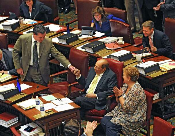Senate Majority Leader John Flanagan gives Deputy Majority Leader Thomas Libous a fist bump to welcome him back to work in the senate chamber at the Capitol on Tuesday, June 16, 2015 in Albany, N.Y. Libous's wife Fran sits next to him on the right. Libous has been battling lung cancer. (Lori Van Buren / Times Union) Photo: Lori Van Buren