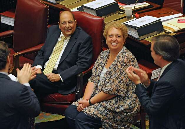 Deputy Majority Leader Thomas Libous and his wife Fran receive a round of applause as his colleagues welcome him back to work in the senate chamber at the Capitol on Tuesday, June 16, 2015 in Albany, N.Y. Libous has been battling lung cancer. (Lori Van Buren / Times Union) Photo: Lori Van Buren