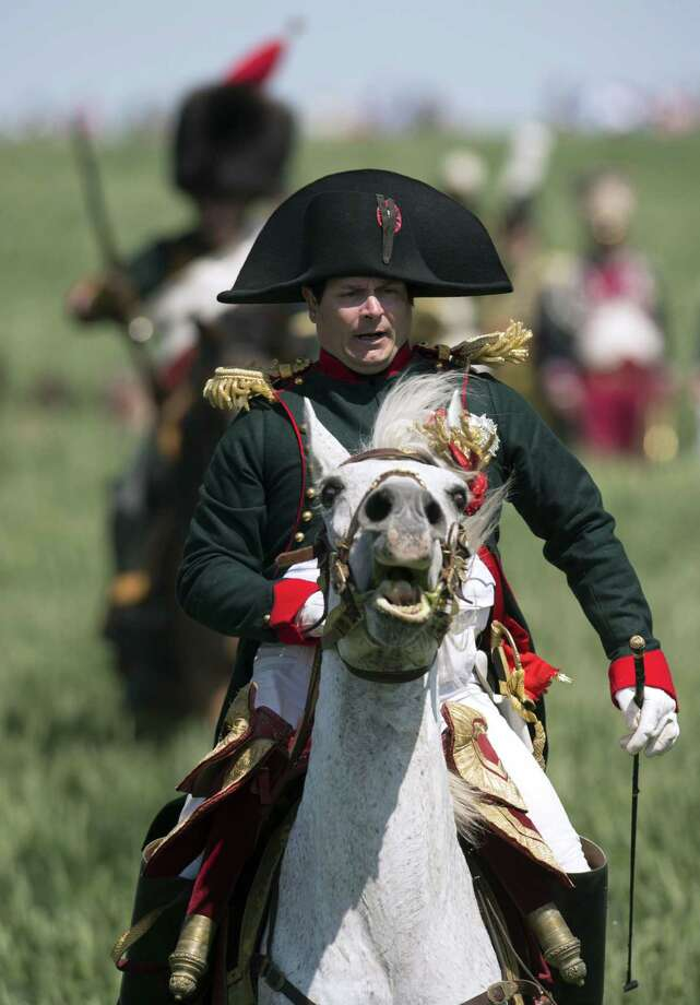 French lawyer Franck Samson, dressed as Napoleon Bonaparte, takes part in a reenactment of the Battle of Ligny, near Namur, central Belgium, on June 14, 2015. Several thousand spectators attended the reenactment of the battle of Ligny, Napoleon's last victory, to mark the civentenary of the Battle of Waterloo. The troops will be part of 5,000 re-enactors in Belgium on June 18, bringing to life a legendary battle in which Wellington and the Prussian general, Gebhard von Bluecher, won a definitive victory over Napoleon.  Photo: JOHN THYS, AFP / Getty Images / AFP