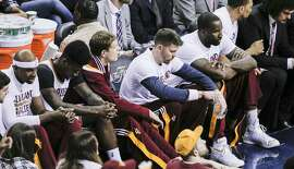 The Cleveland Cavaliers' bench is quiet in the third period during Game 6 of The NBA Finals between the Golden State Warriors and Cleveland Cavaliers at The Quicken Loans Arena on Tuesday, June 16, 2015 in Cleveland, Ohio.