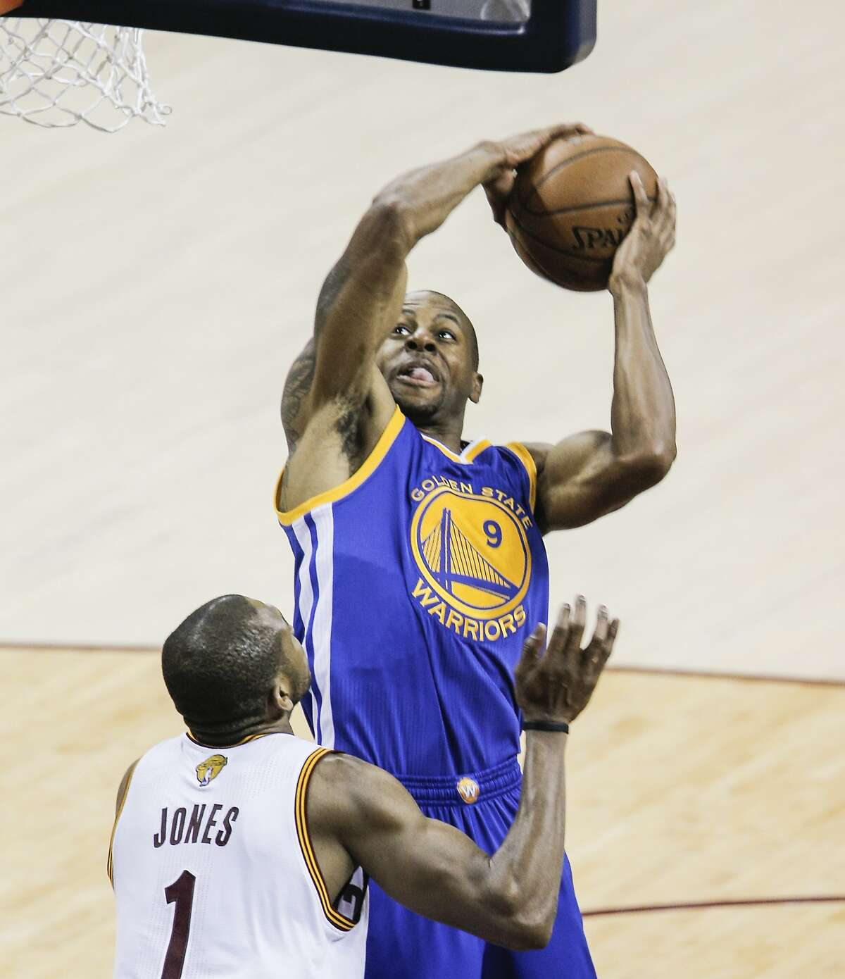 Golden State Warriors' Andre Iguodala tries to shoot over Cleveland Cavaliers' James Jones in the third period during Game 6 of The NBA Finals between the Golden State Warriors and Cleveland Cavaliers at The Quicken Loans Arena on Tuesday, June 16, 2015 in Cleveland, Ohio.