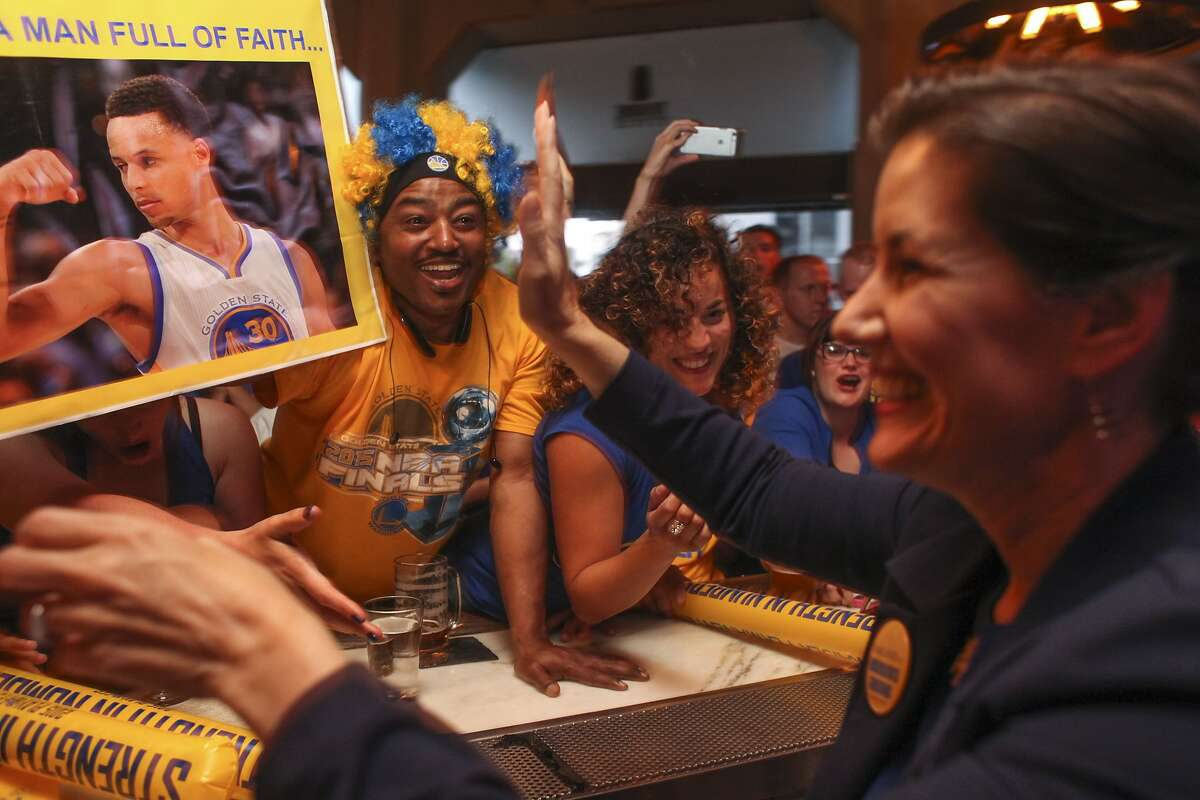 Libby Schaaf, Mayor of Oakland cheers with fans during game 6 of the NBA finals at the Tribune Tavern in downtown Oakland on June 16th 2015. The Golden State beat the Cleveland Cavaliers to win the championship.