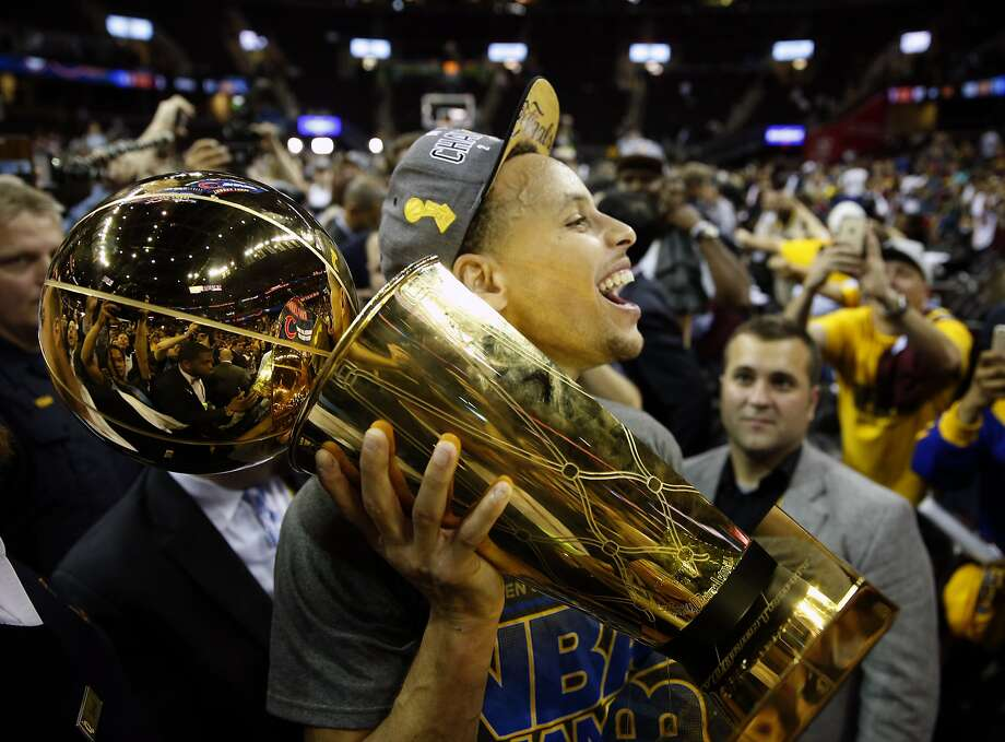 Golden State Warriors' Stephen Curry carries the Larry O'Brien Trophy off the court after defeating Cleveland Cavaliers in Game 6 of NBA Finals at Quicken Loans Arena in Cleveland, Ohio, on Tuesday, June 16, 2015. Photo: Scott Strazzante, The Chronicle